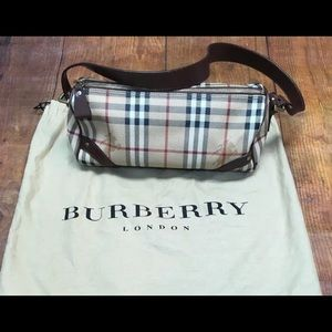Authentic Burberry PVC leather Barrel Hand bag.